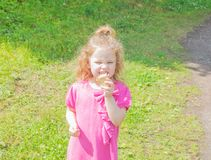 In the Park the child walks with ice cream in hand Stock Images