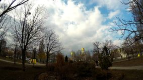 Park with a church under the blue sky. In Kiev stock footage
