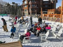 Skiers on lunch break at Deer Valley. Park City, UT, December 27, 2017: Skiers are take a break for lunch and rest at the Silver Lake Lodge at Deer Valley Resort Royalty Free Stock Image