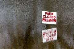 Park closed due to flooding. Sign showing that a park is closed due to excessive flooding Stock Photos