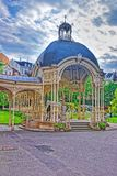 Park Colonnade with wooden Arbor in Karlovy Vary. Czech republic. People on the background Royalty Free Stock Image
