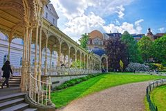 Park Colonnade with wooden Arbor Karlovy Vary. Park Colonnade with wooden arbor, Karlovy Vary, Czech republic. People on the background Royalty Free Stock Photos