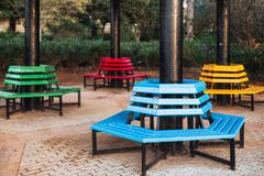 Park colored benches located around the column stock photography