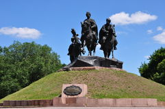 Park Cossack glory. Park, greenery, grass, monument, sky, clouds, three cossacks, horse, monument, mountain Stock Photography