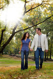 Park Couple Walk Stock Photo