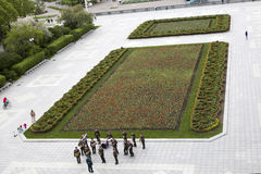 Park of Culture. View from above. The musicians rehearse before the performance around the lawn with tulips. Stock Images