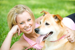 Park: Cute Woman with Dog. Series with girls walking and playing in a park in Spring, with a dog Stock Photo