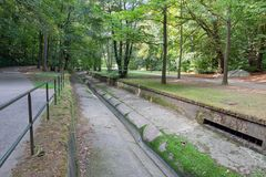 Park downtown Luxembourg city with footpath along Petrusse creek. Affluent of Alzette river stock photo