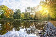 Park in the early fall with the lake. Park in the early fall with the lake royalty free stock images