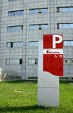 Park entrance to building. Park entrance sign with modern chinese building in background Stock Photo