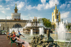 Park of the Exhibition of Achievements of National Economy, Mosc. MOSCOW - JULY 29, 2016: Tourists are resting near the Stone Flower Fountain in Exhibition of Stock Images