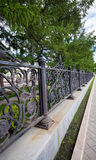 Park fence. Elegant iron metal park fence royalty free stock image
