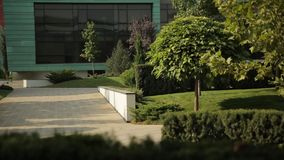 Park in front of the large modern building stock video footage