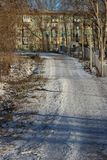 Park frosty sunny afternoon. Jogging track in a snow-covered park on a frosty sunny day in the city of Cherepovets, Vologda region royalty free stock photography