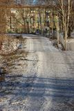Park frosty sunny afternoon. Jogging track in a snow-covered park on a frosty sunny day in the city of Cherepovets, Vologda region stock photography