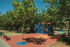 Park full of leafy trees and playground at Merida. Merida, Spain - July 05, 2018. Park full of leafy trees and children playground in a sunny day at Merida royalty free stock photography