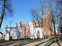 Park gate and church, Lithuania Stock Images