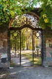 Park gates. Picture of walking alley and gates in autumn park Stock Photography