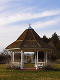 In the park. Gazebo in the park with brown roof Stock Photos