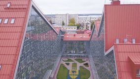 Park between glass buildings. Clip. Top view of resting place with lawn between glass facades of buildings. Secluded. Place surrounded by glass building stock photos