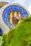 Park Guell by architect Gaudi in a summer day in Barcelona, Spain. Architectural detail of a fountain made from a colored mosaic. stock images