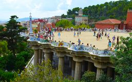 Park Guell in Barcelona, Spain. Park Guell, Barcelona, Spain. Sightseeing: Bench, Gatekeeper`s House, Stairs and `Hall of a hundred columns Royalty Free Stock Images