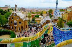 Park Guell in Barcelona, Spain. Park Guell, Barcelona, Spain. Sightseeing: Bench, Gatekeeper`s House, Stairs and `Hall of a hundred columns Royalty Free Stock Photo