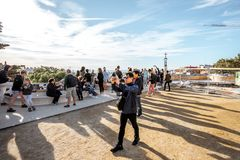 Park Guell in Barcelona. BARCELONA, SPAIN - August 17, 2017: View on the main terrace full of tourists in Guell park famous public park with gardens and Stock Images
