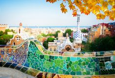 Park Guell, Barcelona. Gaudi bench and cityscape of Barcelona from park Guell, famous view of Barcelona, Spain at fall stock photography
