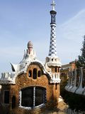 Park Guell. Barcelona, the house with white blue tower Royalty Free Stock Images