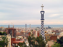 Park guell in barcelona, spain. The famous park Guell in barcelona at sunset - the city skyline and the mediterranean sea in the background Royalty Free Stock Photo