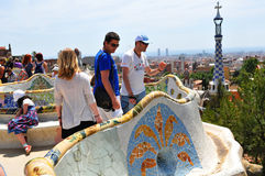 Park Guell in Barcelona, Spain. Barcelona, Spain - 7 July, 2012: Tourists visiting the Parc Guell (Guell Park), major touristic landmark designed by the famous Royalty Free Stock Photography