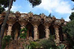Park Guell in Barcelona, Spain. Park Guell, Barcelona, Spain. Sightseeing: Bench, Gatekeeper`s House, Stairs and `Hall of a hundred columns Stock Photo