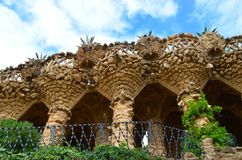 Park Guell in Barcelona, Spain. Park Guell, Barcelona, Spain. Sightseeing: Bench, Gatekeeper`s House, Stairs and `Hall of a hundred columns Stock Images