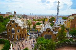 Park Guell in Barcelona, Spain. Park Guell, Barcelona, Spain. Sightseeing: Bench, Gatekeeper`s House, Stairs and `Hall of a hundred columns Stock Image