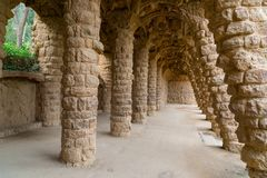 Park Guell in Barcelona, stone colonnade. Stone carved columns in colonnade of Park Guell, designed by Gaudi, Barcelona, Catalonia, Spain. Architectural details Royalty Free Stock Photography