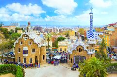 Park Guell in Barcelona. View to entrace houses with mosaics on foreground. Panoramic view of Park Güell - gingerbread houses with a mosaic by architect royalty free stock photos