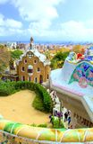 Park Guell in Barcelona. View to entrace houses with mosaics on foreground. Panoramic view of Park Güell - gingerbread houses with a mosaic by architect royalty free stock image