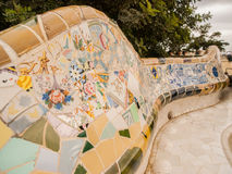 Park Guell Bench. Detail of ceramic mosaic bench in Park Guell designed by artist Antoni Gaudi in Barcelona, Spain, Europe Royalty Free Stock Image
