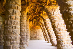 Park Guell. Gaudi stone galleries formed by sloping columns Stock Image