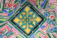 Park Guell mosaic. Colorful mosaic in Antoni Gaudi's Park Guell - Barcelona detail. Artistic background texture of trencadis Stock Photography