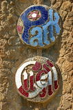 Park Guell Mosaic Plate. Plate in the entrance of the Park Guell designed by Gaudi Stock Photography