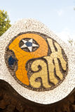 Park Guell Mosaic Sign. Mosaic Sign in Antoni Gaudi's Park Guell in Barcelona, Spain Stock Image