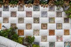 Park Guell mosaic wall, Barcelona. Mosaic wall at the entrance to the famous Park Guell in Barcelona, Catalonia, Spain. Architectural detail Stock Image