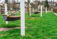 Park, hammocks in public garden, relax and recreation. stock photography