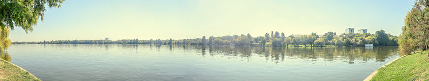 Park Herastrau with green trees and water lake, panorama landscape Royalty Free Stock Image