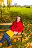 In the park with homework Royalty Free Stock Images