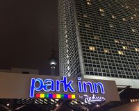 Park Inn by Radisson in Berlin Alexanderplatz. Berlin, Germany - November 30, 2017: Park Inn by Radisson signboard. Radisson Hotels is an international hotel Royalty Free Stock Photography