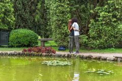 Park in italy green spring. A couple making selfie in a hug Royalty Free Stock Photography