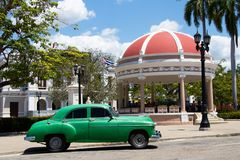 Park Jose Marti in Cienfuegos with vintage car, Cuba royalty free stock photo